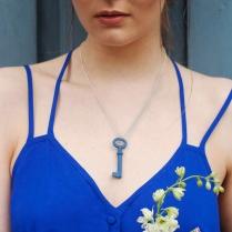 Blue porcelain key necklace on model
