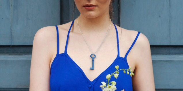 Blue porcelain key necklace on model