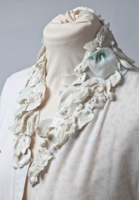 Porcelain neck piece protection, referencing chain mail segments.