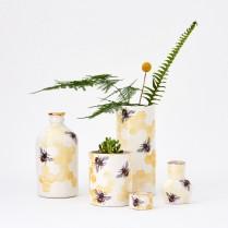 Porcelain bee planter bottles, vase and ring pot
